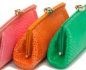 Le clutch luxury in pitone e struzzo di Desmo
